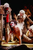 centre: Antony Sher (Marcel Flote), Polly James (Marguerite) in RED NOSES by Peter Barnes at the Royal Shakespeare Company (RSC), Barbican Theatre, Barbican Centre, London EC2 02/07/1985 design: Farra...