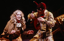 Polly James (Marguerite), Jim Hooper (Sonnerie) in RED NOSES by Peter Barnes at the Royal Shakespeare Company (RSC), Barbican Theatre, Barbican Centre, London EC2 02/07/1985 design: Farrah lighting: T...