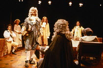 facing camera, l-r: Mark Rylance (Damis), Stephanie Fayerman (Dorine), David Glover (Officer), David Bradley (Cleante), Antony Sher (Tartuffe) in TARTUFFE by Moliere at the Royal Shakespeare Company (...